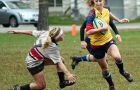 Gaels' centre Allison Burns gains ground against Brock during Friday's 23-10 win over the Badgers.