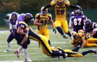 Gaels defensive back Jimmy Allin tackles Golden Hawks running back Mike Montoya during Saturday's 25-13 loss in Waterloo.