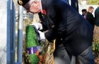 A veteran places a wreath on a monument at Kingston's Royal Canadian Legion branch.