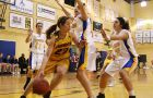 Gaels' guard Paige Robinson (middle) dives to keep the ball in play at Bartlett on Saturday. The Gaels beat Ryerson 69-65.
