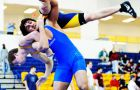 Tavis Sisco grapples with an opponent at the Queen's open over the weekend.