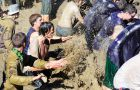 Upper-year Engineering students dive into the pit to splash the frosh surrounding the pole.