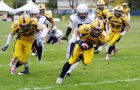 Defensive back Josh Sultana recovers a fumble a touchdown during the Gaels' 37-0 win over the Western Mustangs on Saturday.