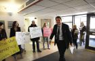 Students and members of Occupy Queen's protested outside Senate on Tuesday in support of the BFA program as Principal Woolf walks past.