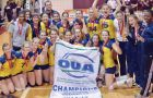 The women's volleyball team celebrates after beating the Ottawa Gee-Gees 3-1 in the OUA final on Sunday.