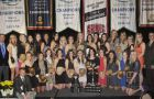 The women's soccer team celebrates with the Jim Tait Trophy for outstanding varsity team;