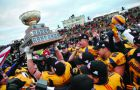 In the years after Queen's celebrated their 2009 Vanier Cup win (above), linemen Shomari Williams and Matt O'Donnell joined two other former Gaels in the CFL.