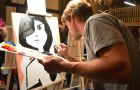 One art battle contestant paints under pressure.