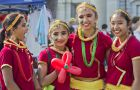 Four young Nepalese dancers smile at the camera following their performance of traditional Nepalese dance at the sixth annual Multicultural Arts Festival.