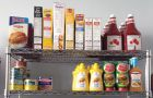 AMS Food Bank stocks its shelves with non-perishable food items.
