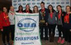 Queen's women's team poses with their second Ontario banner in a row.