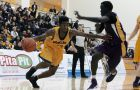 Point-guard Sammy Ayisi drives past the Laurier defender on Friday night.