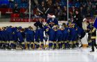 The women's hockey team huddles prior to the game.